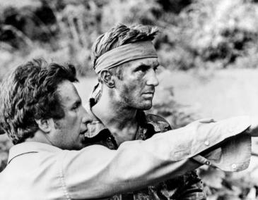 "Michael Cimino and Robert De Niro on the set of ""the Deer Hunter."" With only one previous effort under his belt (the crime action pic Thunderbolt and Lightfoot (1974), Cimino exploded on the scene with this epic three hour war drama, a huge box office success that won 5 Oscars, including Best Picture, Best Supporting Actor (Christopher Walken) and Best Director (Cimino). Scuttling the conventional wisdom that audiences didn't want to see movies about the Vietnam War, it opened the floodgates for Coppola's Apocalypse Now (1979), Oliver Stone's Platoon (1986) and Kubrick's Full Metal Jacket (1987)."