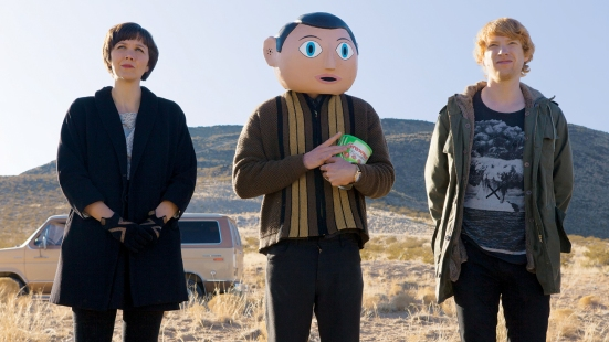 "Maggie Gyllenhaal as ""Clara"", Michael Fassbender as ""Frank"", and Domhnall Gleeson as ""Jon"" in Frank (2014)"