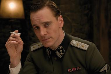 "Michael Fassbender as British Army Lieutenant ""Archie Hicox,"" personally picked out by Sir Winston Churchill to go undercover as a German Captain to obtain important information on the Third Reich from von Hammersmark regarding operation ""KINO"""