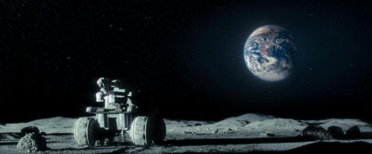 "The director took steps to minimise production costs, such as keeping the cast small and filming in a studio. Moon was produced at Shepperton Studios, in London, where it was filmed in 33 days. Jones preferred using models to digital animation. Jones worked with Bill Pearson, the supervising model maker on Alien, to help design the lunar rovers and helium-3 harvesters in the film. The Moon base was created as a full 360-degree set, measuring 85–90 feet (26–27 m) long and approximately 70 feet (21 m) wide. The film's robot, GERTY, was designed to be bound to an overhead rail within the mining base since its mechanical tether was critical to the story's plot. The visual effects were provided by Cinesite, which has sought cut-price deals with independent films. Since Jones had an effects background with TV advertisements, he drew on his experience to create special effects within a small budget. The director described the lack of romance in the Moon as a location, citing images from the Japanese lunar orbiter SELENE: ""It's the desolation and emptiness of it...it looks like some strange ball of clay in blackness.... Look at photos and you'll think that they're monochrome. In fact, they're not. There simply are no primary colours."" Jones made reference to the photography book Full Moon by Michael Light in designing the look of the film."